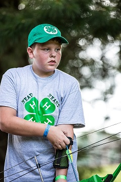 Image of youth shooting archery.